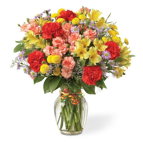 Bouquet of red carnations, yellow alstroemeria, and colorful poms