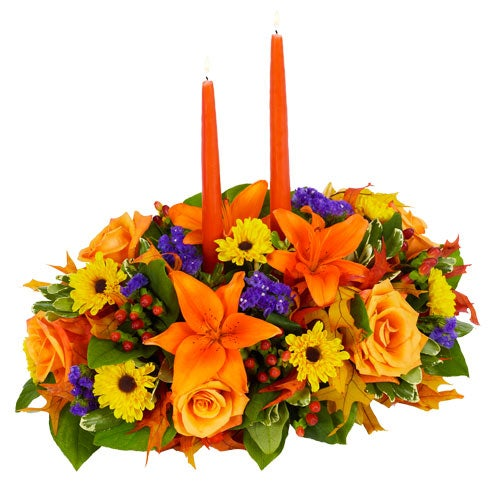 Thanksgiving Floral Centerpiece for delivery, arranged with flowers and candles.