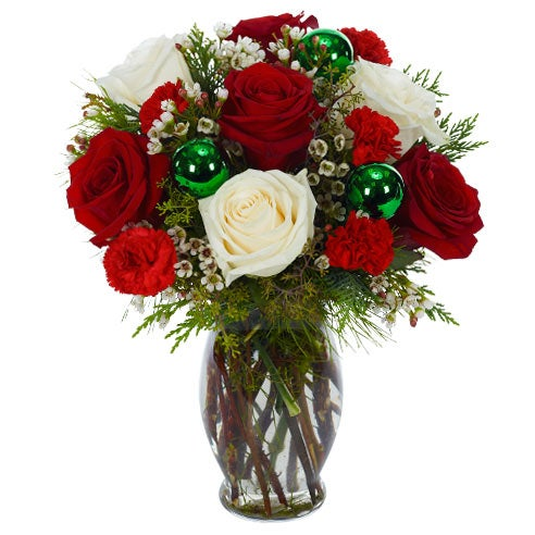 contemporary christmas flowers arrangement with red roses, white roses and ornaments