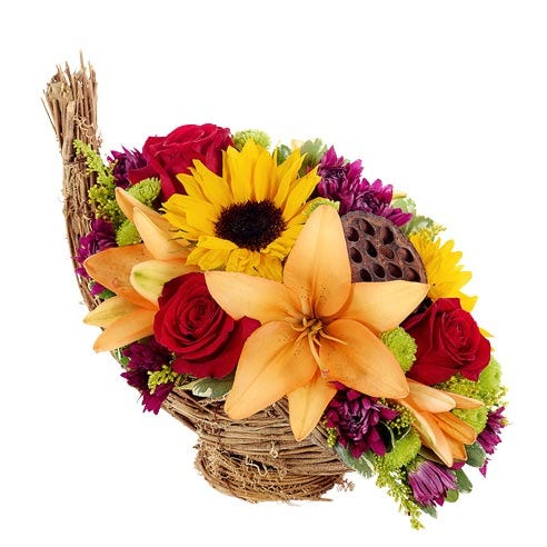 Cornucopia flower bouquet centerpiece with sunflowers and red roses in basket