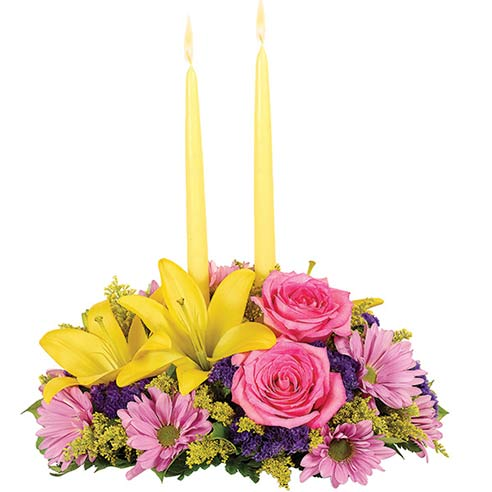 Flower centerpiece from send flowers with pastel flowers, pink roses and yellow flowers