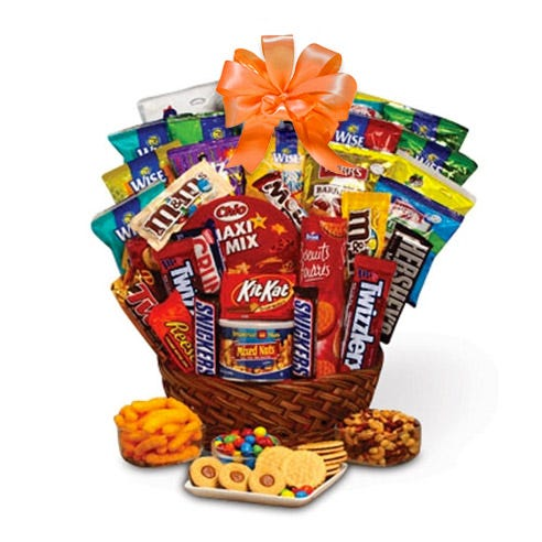 Halloween candy gift basket with cookies, chocolate bars, nuts, chips and more