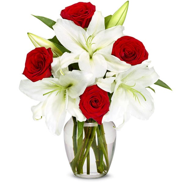 boxed red roses and white lily delivered in a box from send flowers