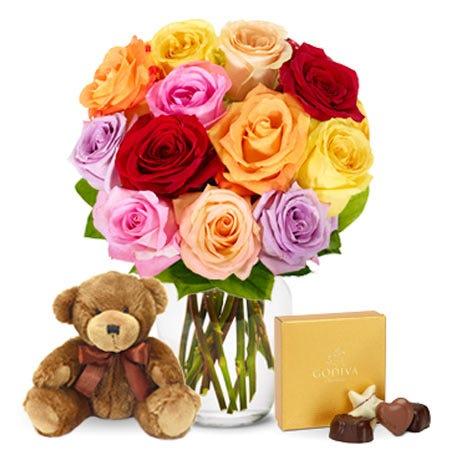 One Dozen Rainbow Roses with Chocolates and Teddy Bear