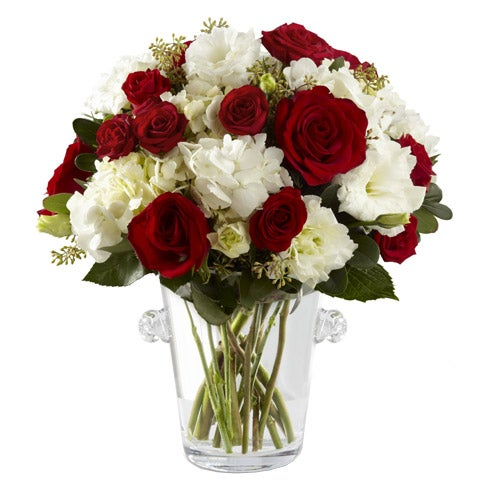 Christmas flowers delivered with red spray roses, white hydrangea and cheap flowers