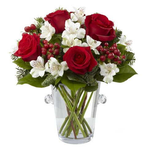 Red roses with white flowers in a modern vase for delivery this holiday