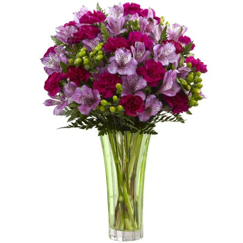 Purple Peruvian lily bouquet delivered in a tall clear glass vase