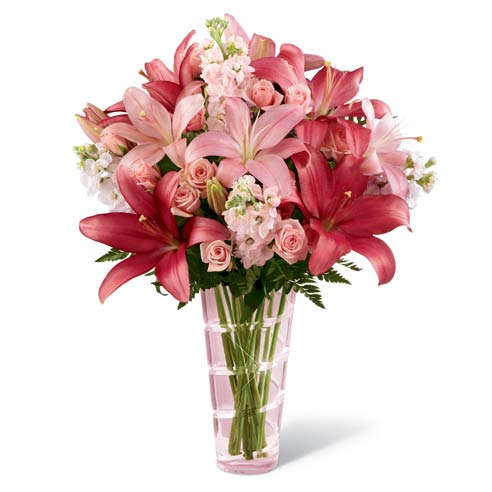 Pink spray roses, pink stock, and pink asiatic lilies with pink stock flowers