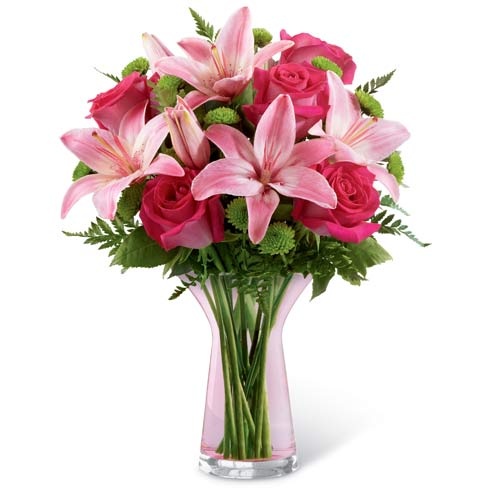 Pale pink lily and hot pink roses bouquet with green button poms and pink vase