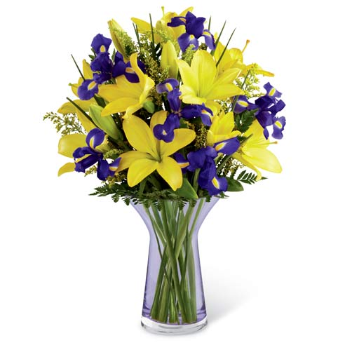 Yellow Asiatic lilies, purple iris and fresh greens for delivery