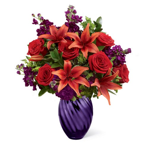 Red asiatic lilies in a purple flower vase for cheap flower delivery online