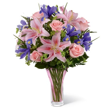 Sweetly elegant bouquet of pink roses, pink oriental lilies, blue irises, and lush greens