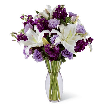 Purple flowers and white lily bouquet