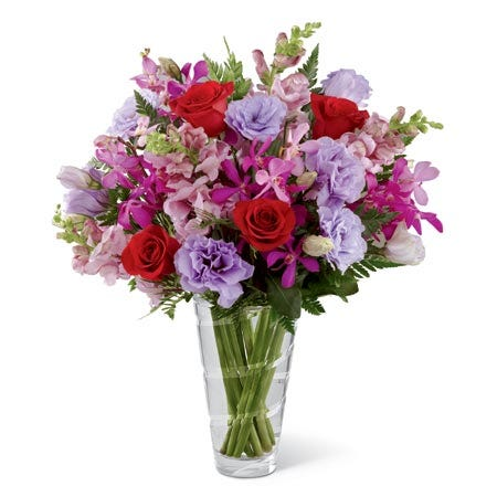Vera Wang purple carnations, red roses and pink mokara orchid bouquet
