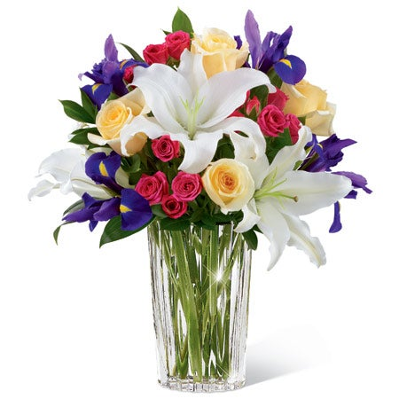 Cheap Mothers Day flower delivery white oriental lilies, purple iris and pink spray roses