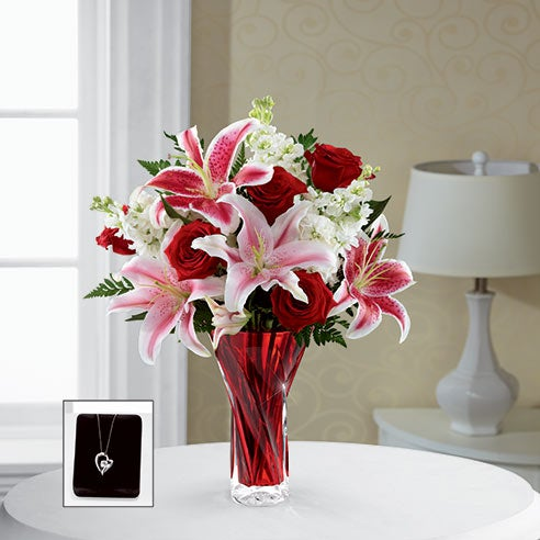 Stargazer lily delivery with stargazer lilies, red roses, and cheap flowers in a vase