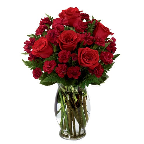 Red rose bouquet in a glass vase with red carnations for same day flower delivery