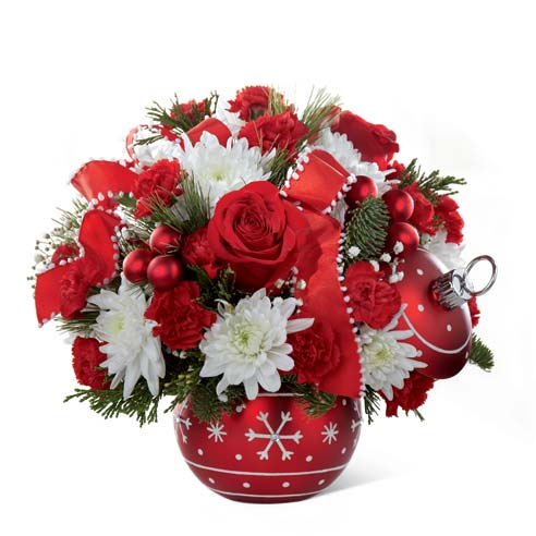 Red roses and red carnations delivered in christmas vase
