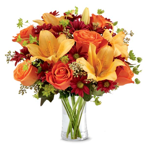 Peach lily and orange rose flower bouquet with dark brown glass vase