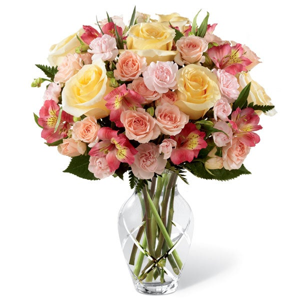 Spring flower bouquet at send flowers with yellow roses, pink carnations and peruvian lilies