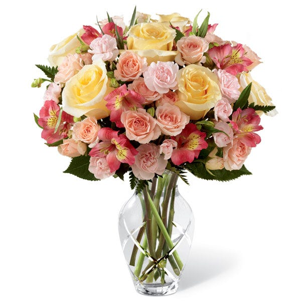 Coral flower bouquet delivery with yellow roses, pink carnations and peruvian lilies