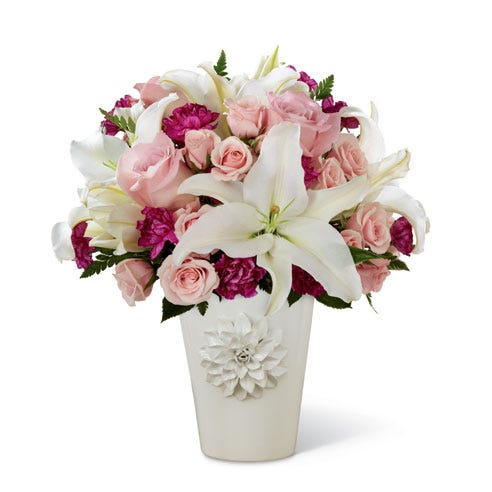White lilies, pink roses and purple carnations