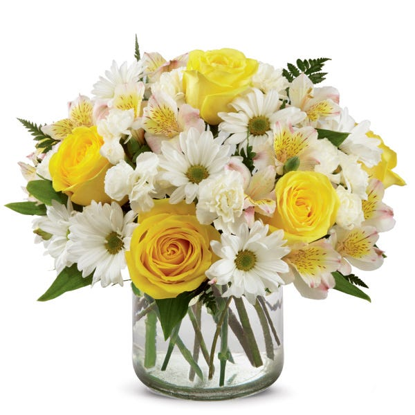 Yellow roses, Rosario Peruvian lilies, white traditional daisies, and white carnations