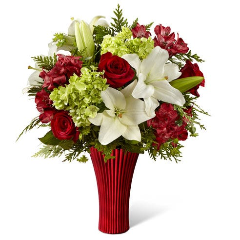Red and green flower bouquet with green stock, white lilies and red roses