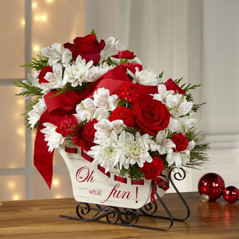 Unique Christmas flower arrangement delivered in a sleigh