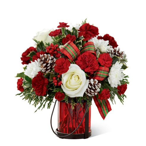 Christmas flowers delivery at send flowers with glass red vase of christmas roses and red berry holly