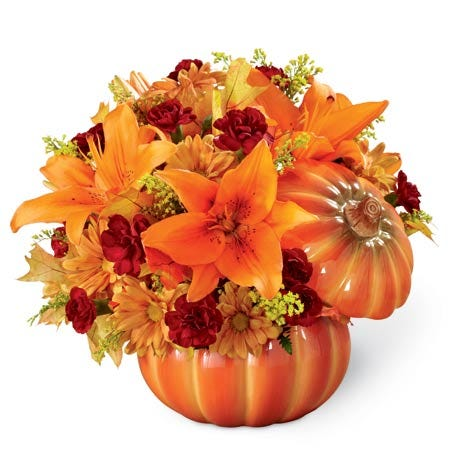 Pumpkin bouquet, orange asiatic lilies and cheap flowers inside a pumpkin
