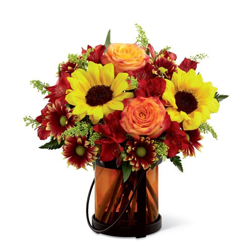 Sunflowers and orange roses in this sunflower bouquet from sendflowers
