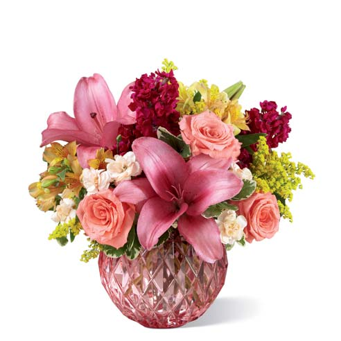 Miniature pink carnations, pink stock and pink roses bouquet with pink vase