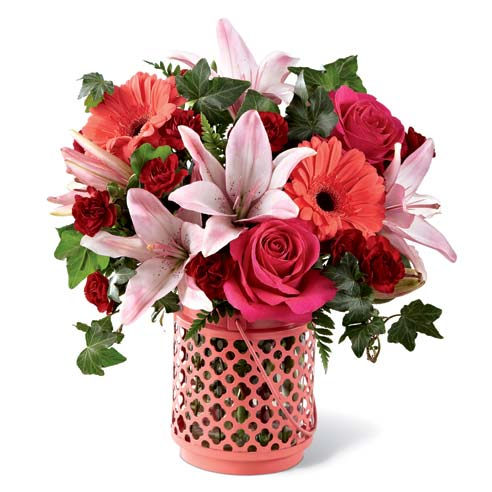 Coral flower candle lantern vase bouquet with coral gerbera daisies and pink lily