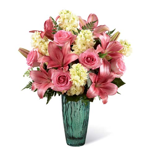 Pink lily and pink rose mixed flower bouquet with yellow stock in a sea-green vase