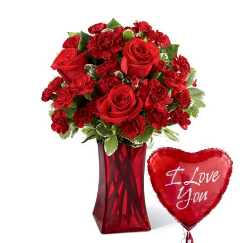 Red roses and red mini carnations in a red vase with an I Love You balloon