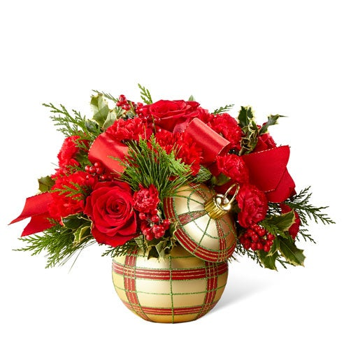 Christmas flowers arrangement with red roses and holly berries for christmas flower delivery