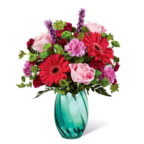Pink gerbera daisies and roses with a variety of flowers