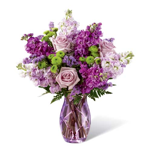Purple flower bouquet with purple roses, lavender roses, purple stock flowers, and green mums