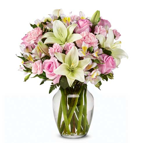 Spring flower bouquet, a white lily and pink rose spring flower arrangement in vase