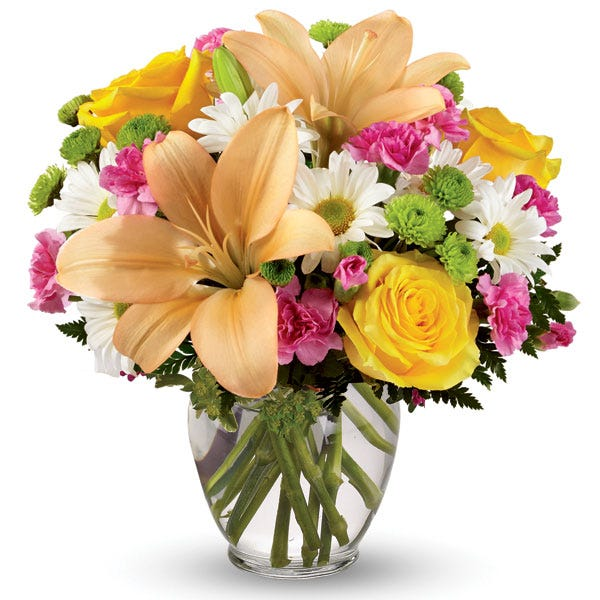 Light orange lily, white daisy, and yellow rose bouquet in a clear glass vase