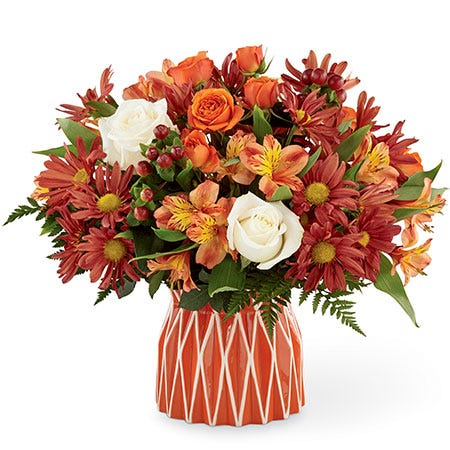 Fall flower arrangement with white and rose roses, red alstroemeria and maroon daisies