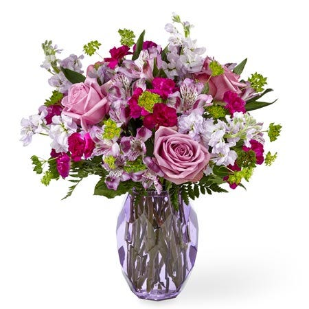 Lavender rose and alstroemeria flowers bouquet with lavender stock in purple vase