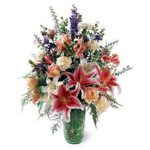 Luxury stargazer lily bouquet in green glass vase