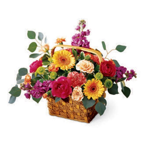 Basket of cheap flowers for delivery with peach roses, purple stock and ranunculus