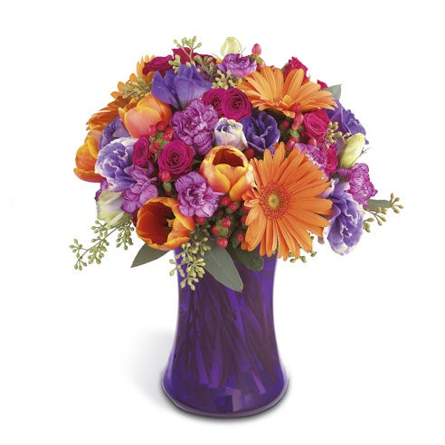 Purple and orange centerpiece with orange tulips and purple flower arrangement