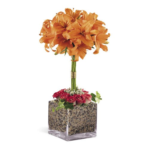 Orange lily flower topiary arrangement with square glass vase and pink roses