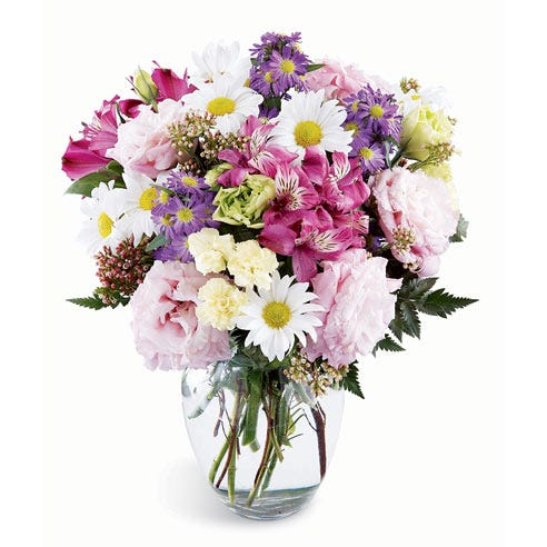 White daisies, pink alstroemeria and purple lisianthks in a mixed bouquet