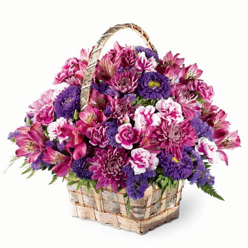 Basket of flowers with cheap flowers featuring purple flowers and purple roses