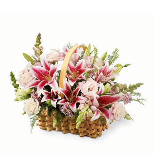 Stargazer lilies basket bouquet and gifts for female CEO